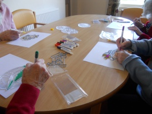 Glass painting with residents at Acacia Court